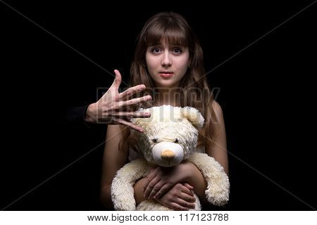 Fearful teenage girl with toy