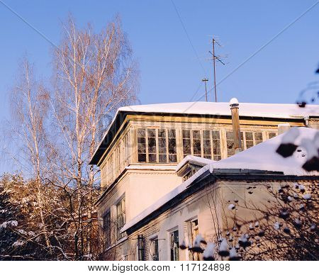 Old abandoned house in winter sunny day