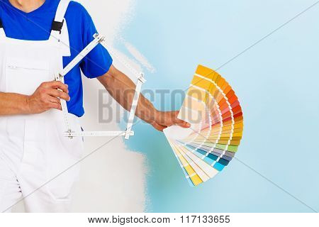 Color Palette And A Yardstick Shaped As An House