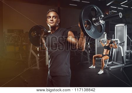 Young And Fit Couple In The Gym Doing Workout