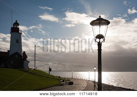 Silhouette Of Lighthouse With Backlight