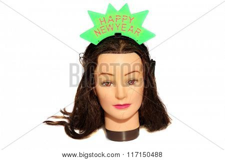 A female Hair Dressers Mannequin Head wears a Happy New Year Light Up Head Band.  Isolated on white with room for your text.