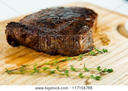 Beautiful Juicy Well Done Steak With Sauce On A Wooden Board
