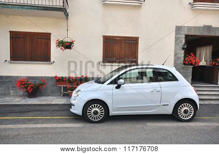 Small Car Parked In The Street