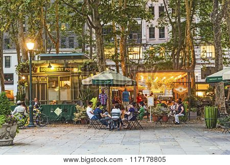 People Enjoy The Evening At Bryant Park In New York
