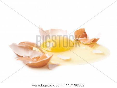Cracked raw chicken egg isolated