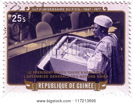 Guinea - Circa 1977: Stamp Printed By Guinea, Shows President Sekou Toure Address The General Assemb