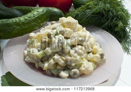 Salad in a dish, cucumber and dill.