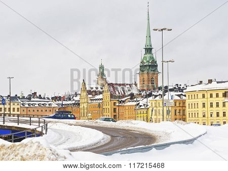 Church of Saint Clare and winter Norrmalm in Gamla Stan. Norrmalm is city district in Stockholm. Stockholm is the capital of Sweden and the most populous city in the Nordic region. Selective focus