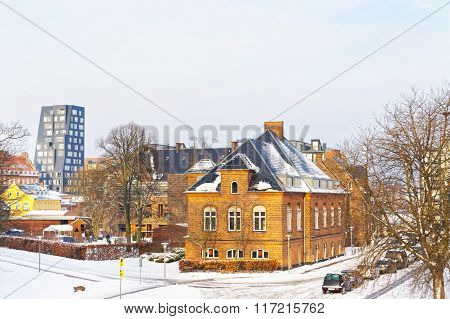 Houses at Langelinie Park Promenade in winter Copenhagen. Langelinie is a pier promenade and park in central Copenhagen Denmark and home of the statue of The Little Mermaid. poster