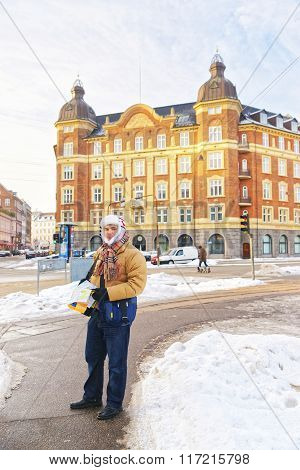 Man Holding Map In Kopenhagen City Center In Winter