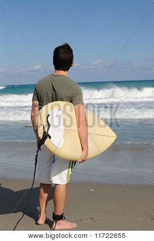 Surfer staring at the Sea