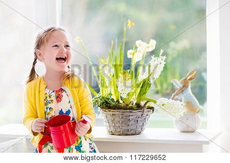 Little Girl Watering Easter Flowers