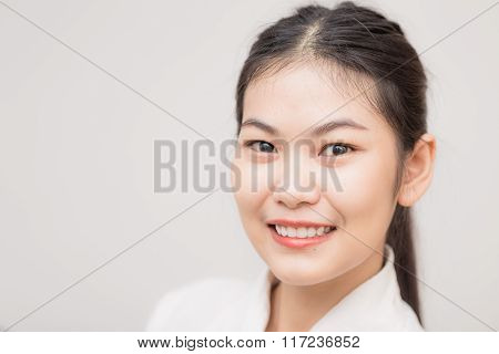 Smiling Asian Caucasian Business Woman.