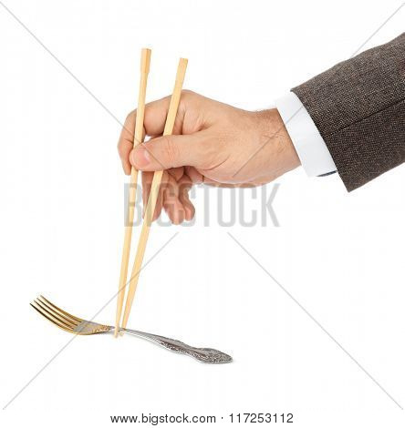 Hand with chopsticks and fork isolated on white background