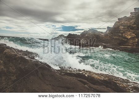 Waves Crashing on Volcanic Rock