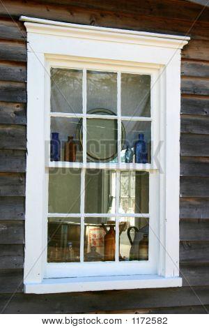 Colonial Window Displaying Bottles
