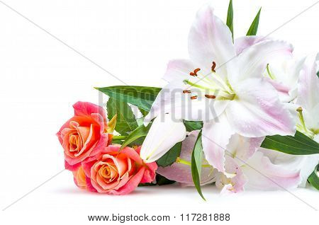 White-pink lilies and three red-orange roses