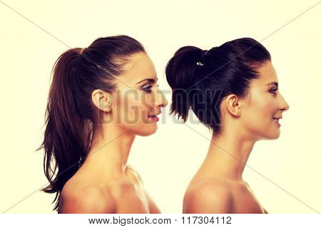 Beauty woman standing behind her friend. poster