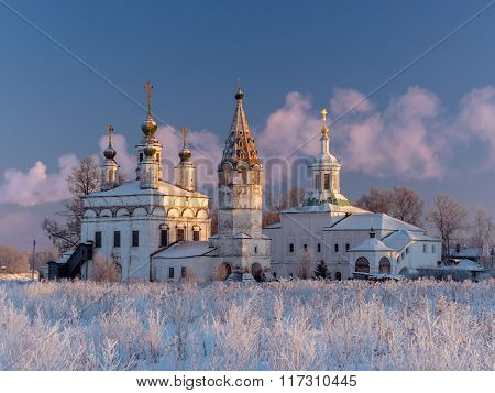 Winter view of the ensemble of ancient orthodox churches in Dymkovo Sloboda (built in 1747) Veliky Ustyug Vologodsky region North Russia poster
