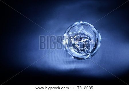 Broken wine glass on dark blue background