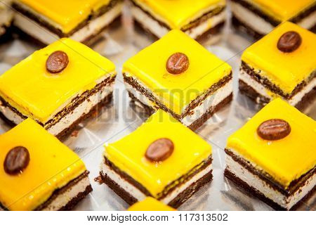 fancy cake with yellow fruit jelly