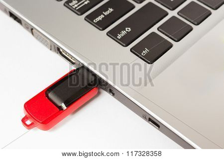 USB flash drive stick connecting to laptop