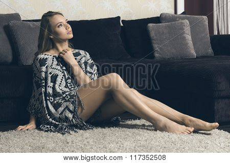 Blond Sexy Sitting On Carpet