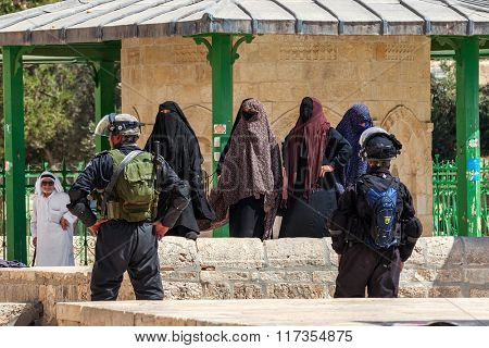 JERUSALEM, ISRAEL - JULY 26, 2015: Palestinian women protest against ascent of jews to Temple Mount during Tisha B'Av - annual fast day in Judaism commemorates destruction of First and Second Temples.