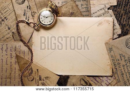 Vintage Pocket Clock On Old Letters Texture