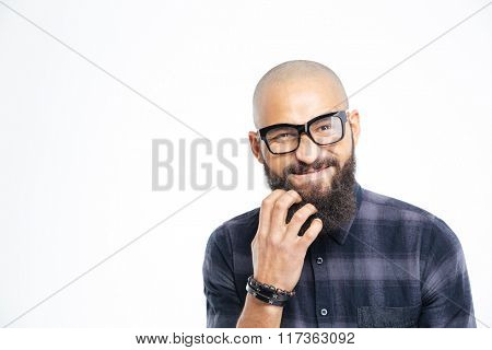 Closeup of handsome baldheaded young african american man in glasses scratching his beard