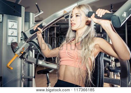 Young Beautiful Girl Training In A Fitness Center