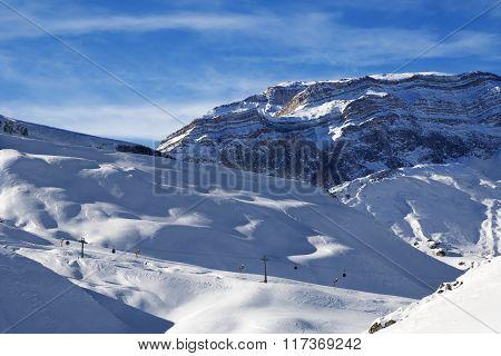 Ski Resort And Sunlight Rocks At Evening