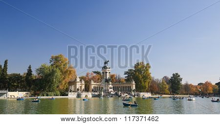 MADRID SPAIN - NOVEMBER 14 2015: Artifical lake and monument to Alfonso XII in the Buen Retiro Park one of the main attractions of Madrid Spain.