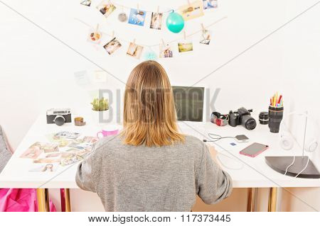 Modern young female photographer at home office