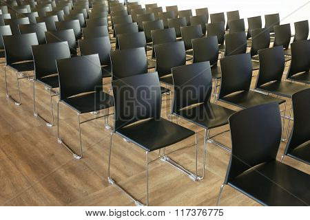 Interior Of Empty Conference Hall With Gray Colored Chairs