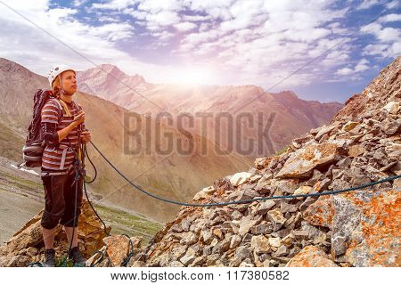 Mountain climber working with rope