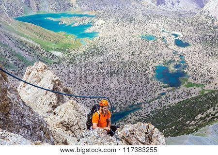Mountain climber over abyss