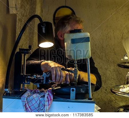 Jewels Cutter Faceting Of Gemstone At Smaal Outdoor Gift Store. Baden-Baden. Germany