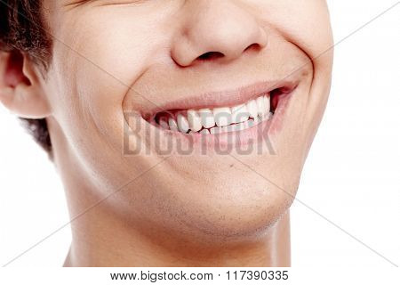 Close up of young man smiling with perfect healthy white teeth isolated on white background - dental care concept