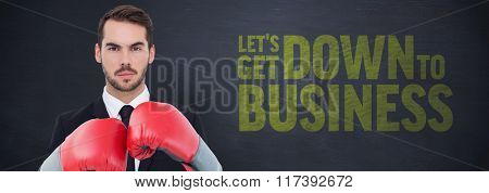 Businessman wearing boxing gloves beside buzz words