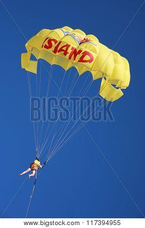 SUS, TUNISIA - OCTOBER 16: The person flies on the parachute on October 16, 2010 in Sus, Tunisia