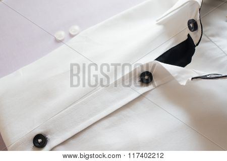 White shirt with black collar and buttons