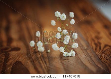 Bunch Of White Fowers Gypsophila On A Wooden Background,