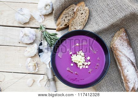 Beet Soup With Garlic And Rosemary, Rye Baguette On A Light Wooden Background