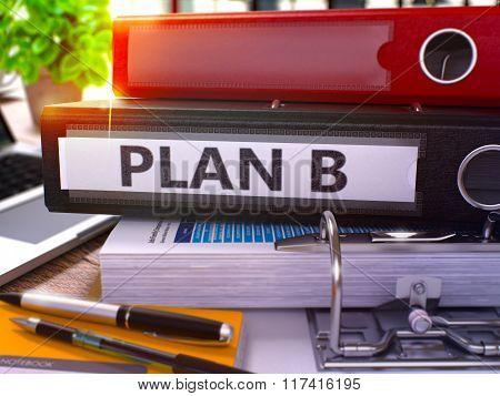Plan B on Black Ring Binder. Blurred, Toned Image.