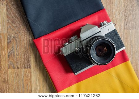 close-up Germany flag and retro photo camera background