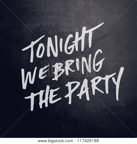 Inspirational Typographic Quote on black chalk board  - Tonight we bring the Party