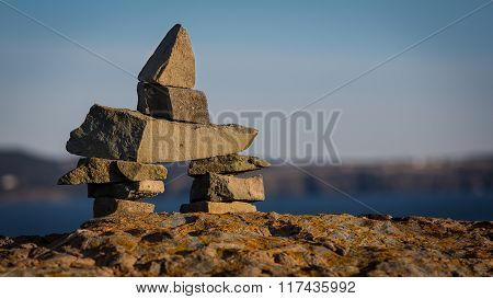 Inukshuk Symbol On A Boulder In Newfounland And Labrador