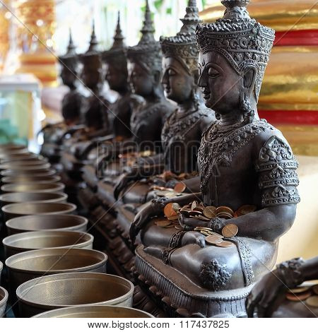 Angel Statue And Monk's Alms Bowl With Put The Coins By Donors In Wat Suan Dok Temple, Chiang Mai, T